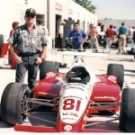 Jim standing next to INDY car 81 / driver Billy Vucovich III